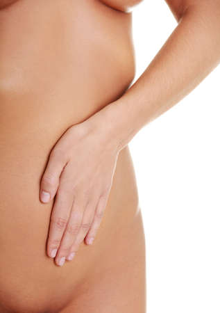 digesting: Fit and slim young woman belly with hand on it Stock Photo