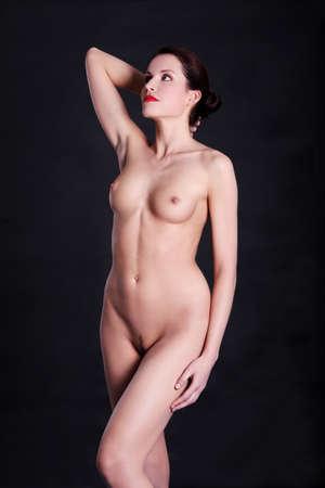 naakt: Sexy lichaam naakt vrouw. Naked sensuele mooie meisje. Artistieke kleurenfoto.