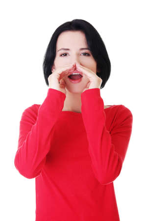 chatty: Pretty caucasian woman whispering gossip. Isolated on white.