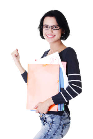 fresh graduate: Happy student woman with notebooks showing win gesture with fist, isoalted on white background  Stock Photo