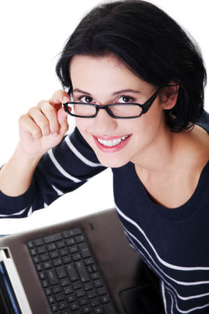 Happy young woman using her laptop, isolated on white.