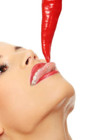 Beautiful woman lips with hot paprika, isolated on white  photo