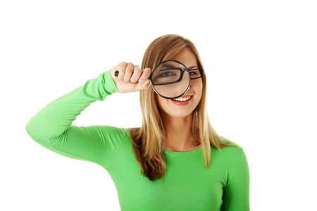 Student woman with magnifying glass isolated on white Stock Photo - 16682701