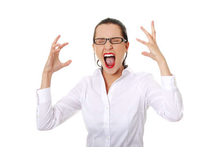 angry woman: Stressed or angry businesswoman screaming loud  Stock Photo
