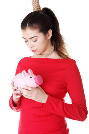 commit: Economic crisis concept  Young woman holding piggy bank going to commit suicide