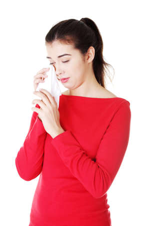 ah1n1: Teen woman with allergy or cold , isolated on white