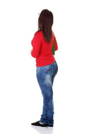 mujer de espaldas: Joven estudiante casual por detr�s, aislado en blanco