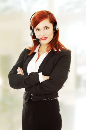 Closeup of attractive customer support representative smiling with headset photo