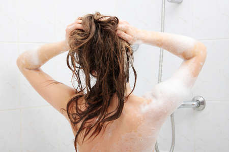 Young fit woman in shower washing her perfect fit body Stock Photo - 16681739