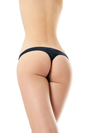 Slim tanned woman's body in black panties. Isolated over white background.  photo
