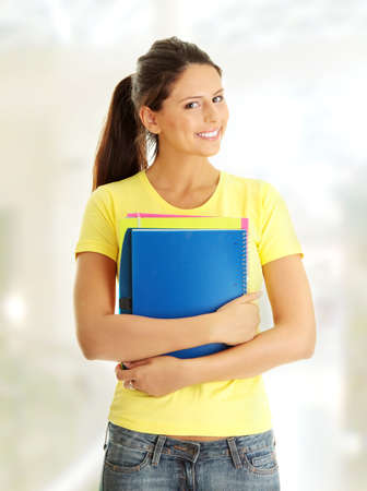 Happy student girl with notebooks photo