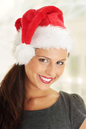 Young business woman in santa hat  photo