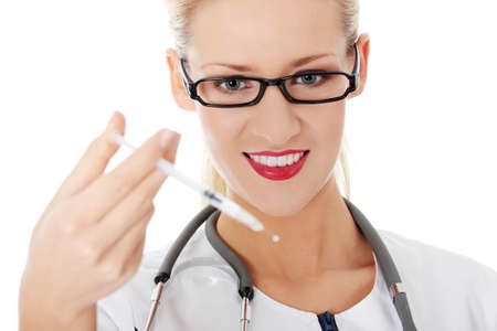 Happy medical doctor or nurse with syringe , isolated  photo