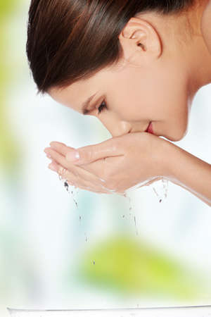 Young beautiful woman cleans her face  photo