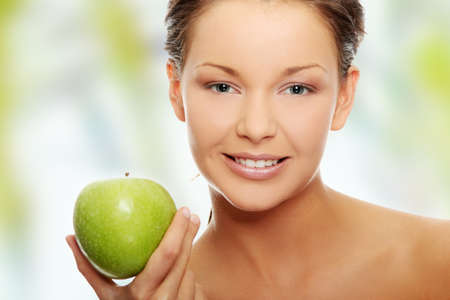 Beautiful  woman with green apple  photo