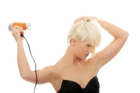 hair drier: Young beautiful blond woman using hair drier