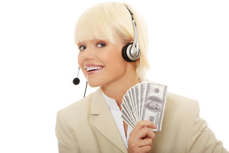 Business woman with headset holding dollars  photo