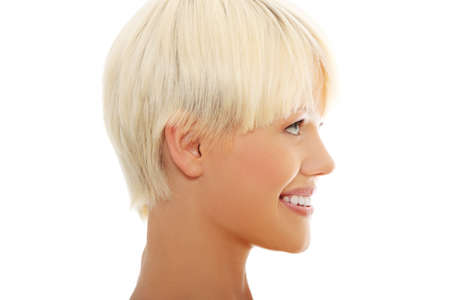 Side portrait of beautiful happy blond woman photo