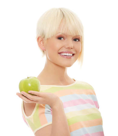 Young woman holding green fresh apple in hand, isolated over white background  photo