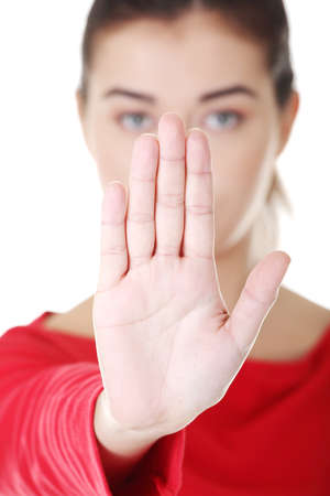 rejecting: Confident woman making stop gesture sing with hand
