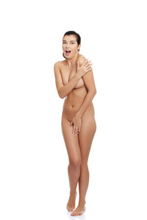 naked young women: Scared nude woman screaming and covering her nudity with hands