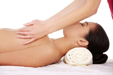 women breast: Beauty young woman relaxing in spa. Breast massage.
