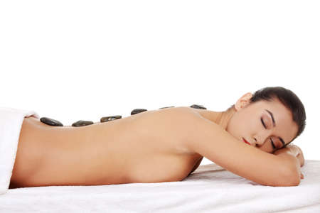 massage spa: Beauty woman relaxing in spa. Stone massage.