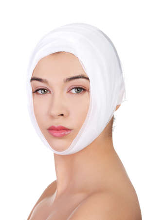 Portrait of beautiful young female face with bandage - beauty treatment plastic surgery  photo