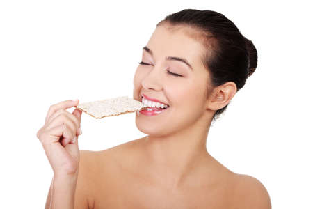 Young pretty woman eating healthy rye cracker bread Stock Photo - 16681076