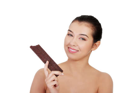 Pretty happy smiling woman eating chocolate waffle, isolated on white Stock Photo - 16679068