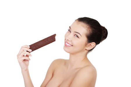 Pretty happy smiling woman eating chocolate waffle, isolated on white Stock Photo - 16680688