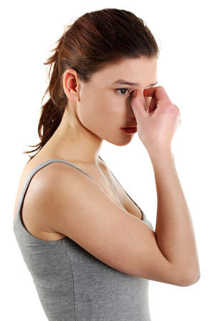 sore eye: Young woman with sinus pressure pain , isolated on white Stock Photo