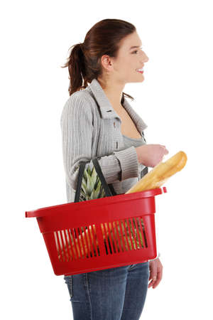 Happy woman with shopping basket , isolated on white background  photo
