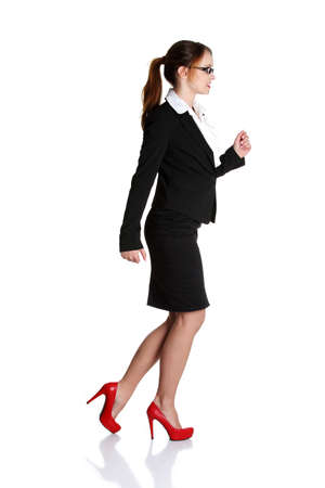 Young happy businesswoman in a rush. Isolated on white photo