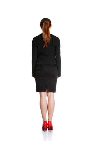 Femme d'affaires de l'arrière - regarder quelque chose sur un fond blanc Banque d'images