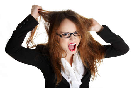 going crazy: Stressed business woman is going crazy pulling her hair in frustration. Stock Photo