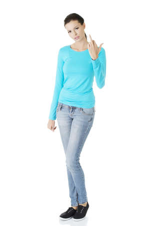 Teen girl with middle finger up, isolated on white background  Stock Photo - 16737562