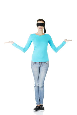 Blindfold woman presenting copy space on her palms, isolated on white Stock Photo