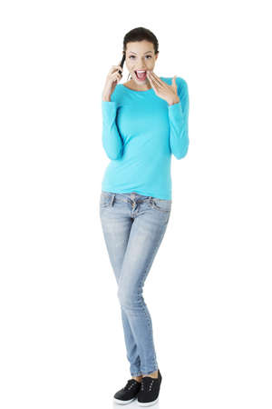 Happy surprised woman with cell phone, isolated on white photo
