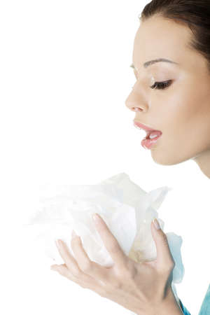 Young woman with tissue - sneezing , isolated on white photo