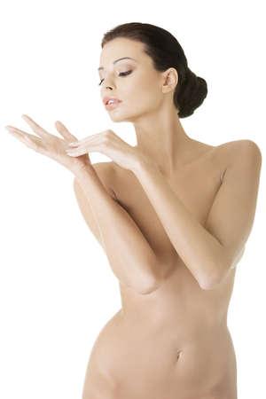 modelo desnuda: Hermosa mujer en topless en forma, aislado en blanco Foto de archivo