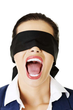Portrait of a beautiful frighten young blindfold woman screaming  Stock Photo