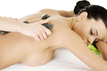 Beauty woman relaxing in spa. Stone massage.  photo