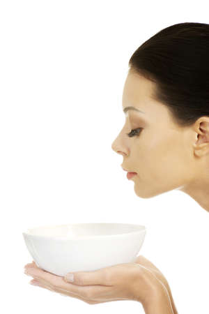 cold soup: Beautiful young woman holding bowl and smells Stock Photo