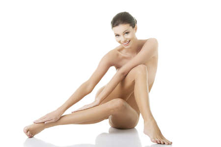 Sexy happy fit naked woman with healthy clean skin, isolated on white background