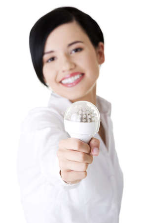 Businesswoman showing eco led bulb, isolated on white Stock Photo - 16772750