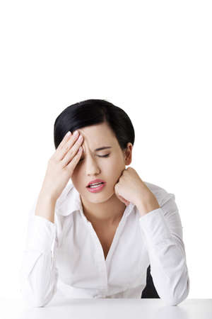 Businesswoman with big problem , headache or depression  Stock Photo - 16772832