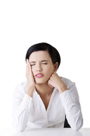 Businesswoman with big problem , headache or depression  Stock Photo - 16772930
