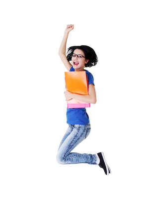 Happy female student jumping with a notebook isolated  Stock Photo - 16770486