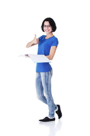 Isolated full length portrait of a beautiful young woman student.  Stock Photo - 16772236
